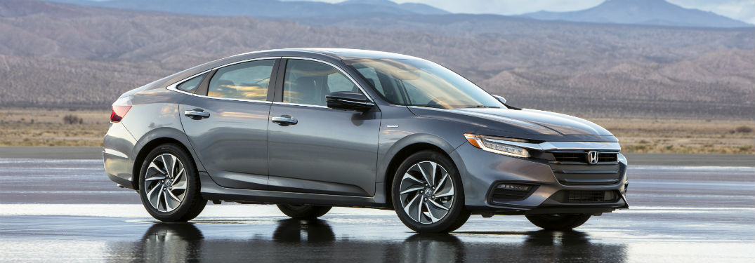 2019 Honda Insight exterior front fascia and passenger side on parking lot mountain background