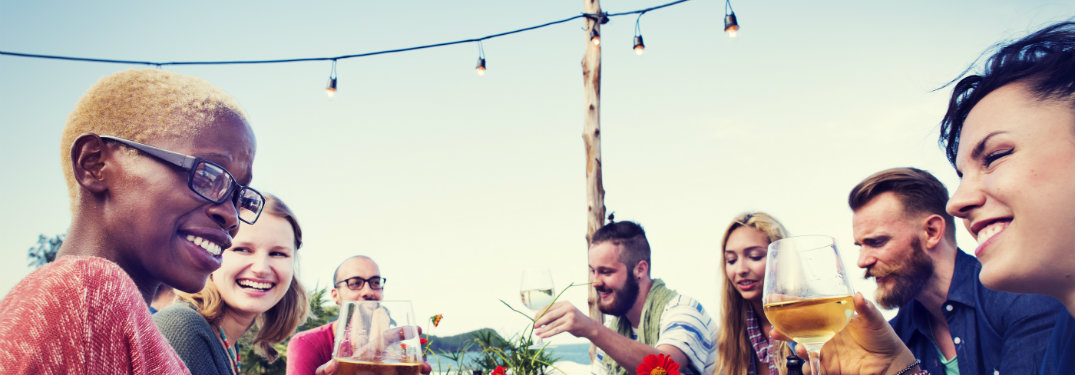 group-of-friends-eating-and-drinking-at-outdoor-restaurant