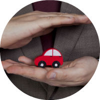 red-toy-car-in-hands