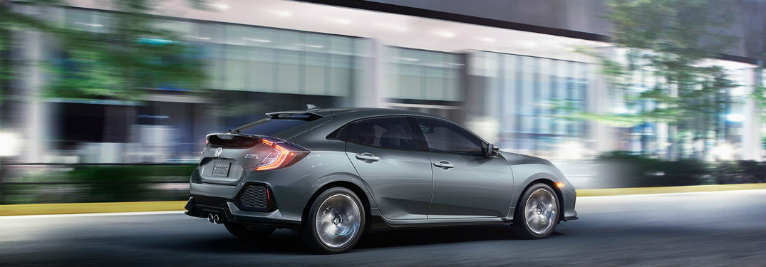 side-profile-of-gray-2018-Honda-Civic-Hatchback-Sport-Touring-driving-at-night