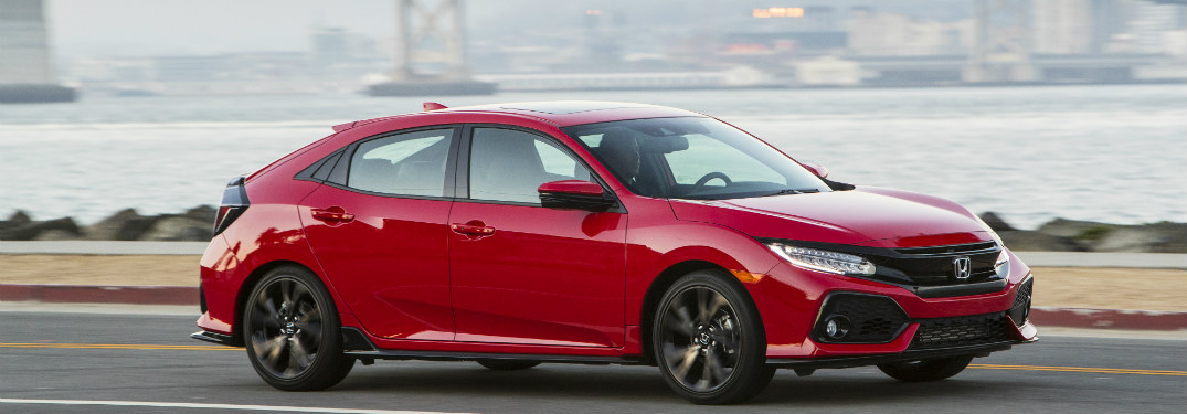 2018 Honda Civic Hatchback driving near shore