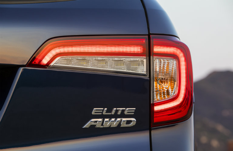Honda pilot Elite AWD badging underneath right taillight