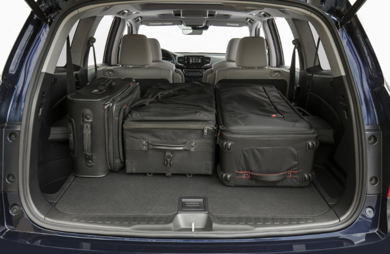 luggage bags packed in rear of honda pilot