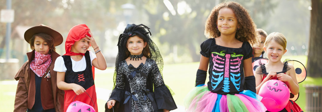 young girls in costume trick or treating