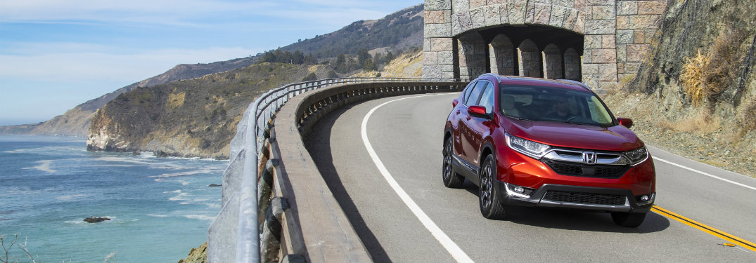 red honda cr-v driving out of tunnel