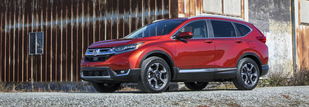 left side view of red honda cr-v parked