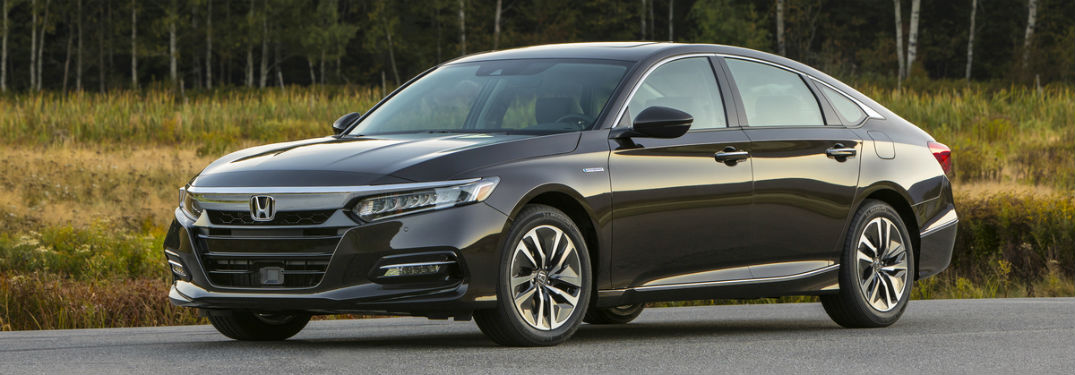 Driver side exterior view of a black 2019 Honda Accord Hybrid