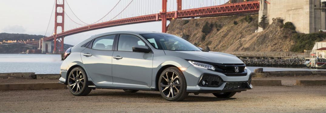 Passenger side exterior view of a gray 2019 Honda Civic Hatchback