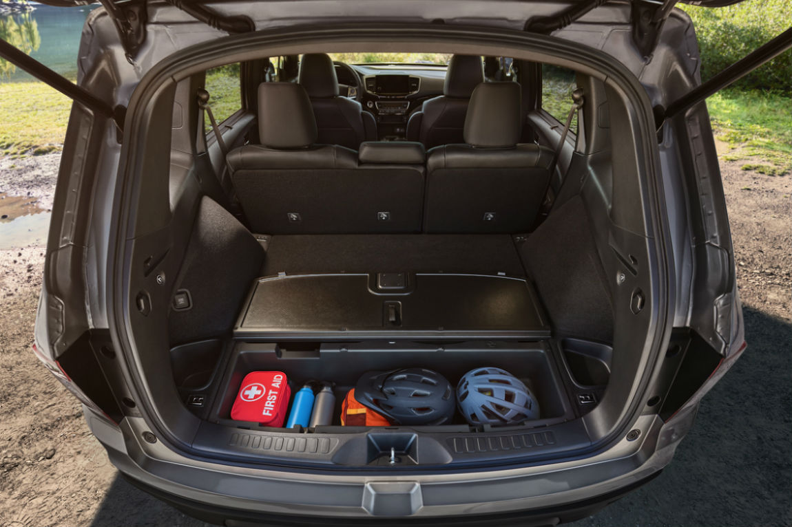 Looking into the cargo area and in-bed trunk of the 2019 Honda Passport