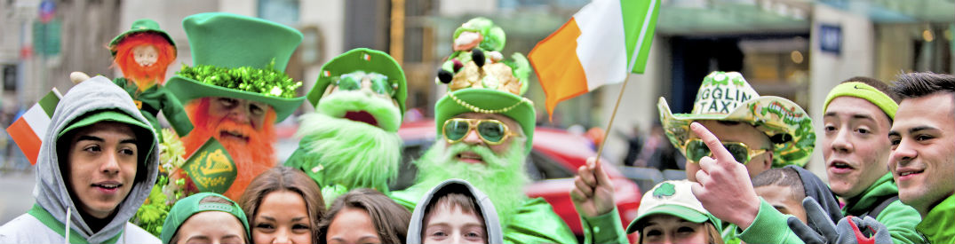 People clad in green clothes and costumes celebrating St. Patrick's Day