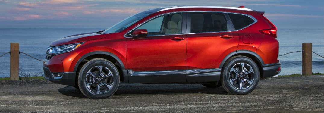 Driver side exterior view of a red 2019 Honda CR-V