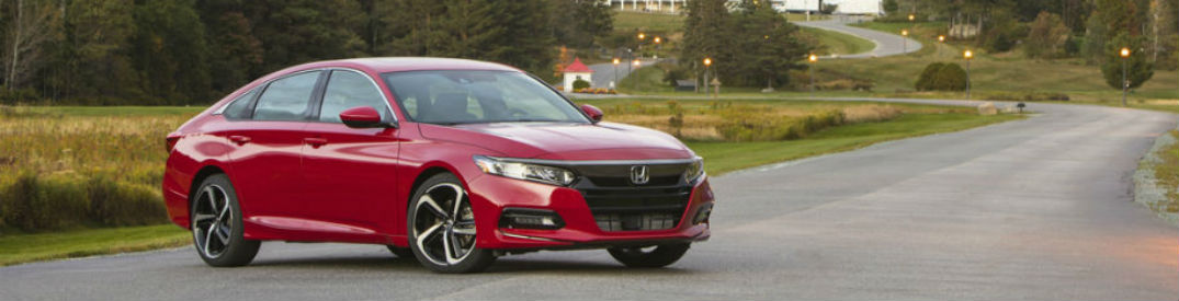 Driver side exterior view of a red 2018 Honda Accord
