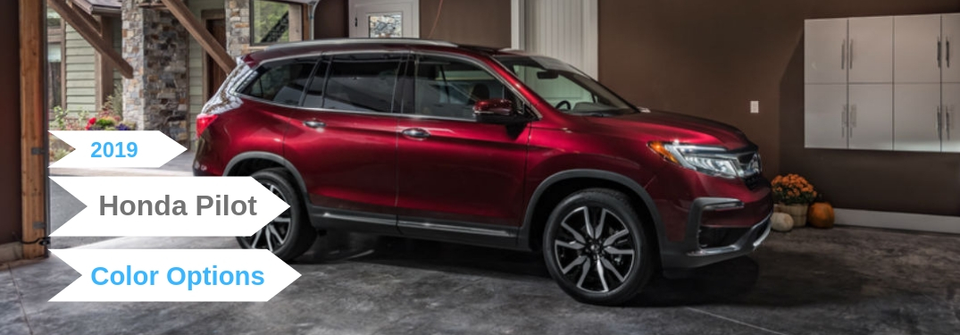 2019 Honda Pilot Color Options, text on a passenger side exterior image of a red 2019 Honda Pilot