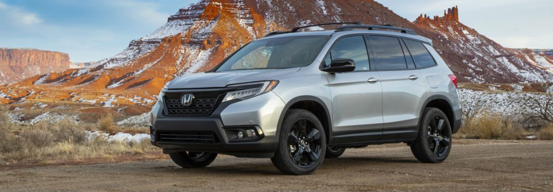 Front driver side exterior view of a gray 2019 Honda Passport