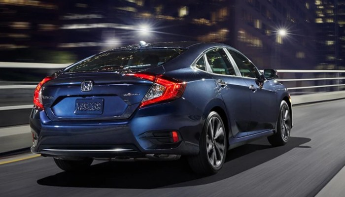 2019 Honda Civic Sedan driving down a city street at night
