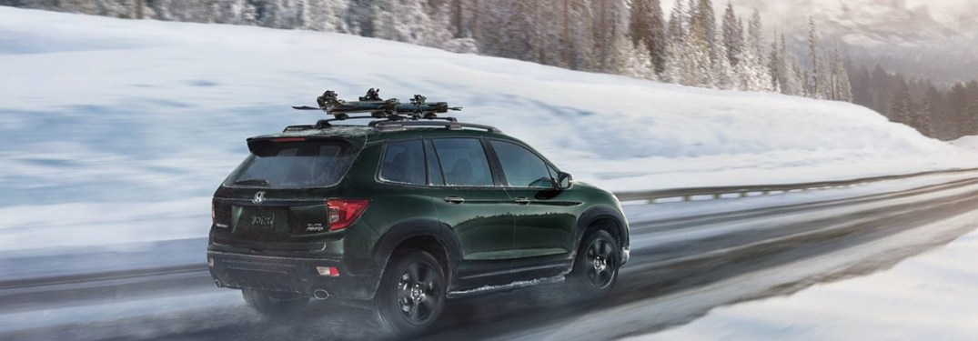 2019 Honda Passport driving down a winter road