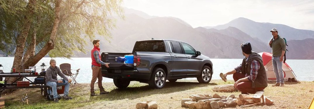 A family camping with a 2019 Honda Ridgeline parked nearby