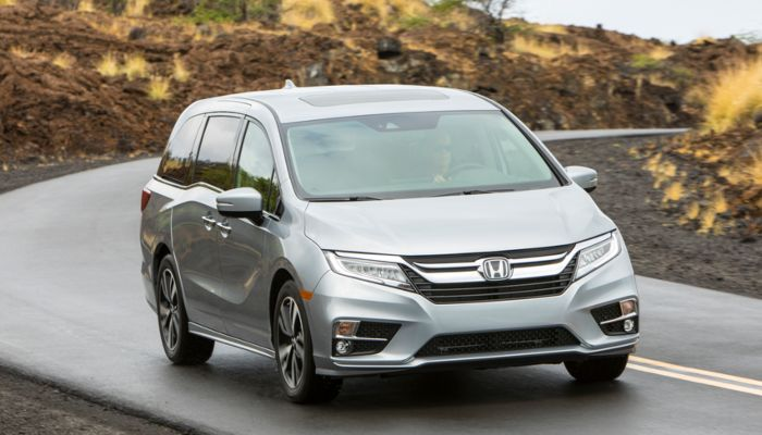 2019 Honda Odyssey driving down a curved road