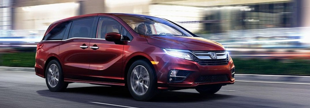2019 Honda Odyssey driving down an urban road