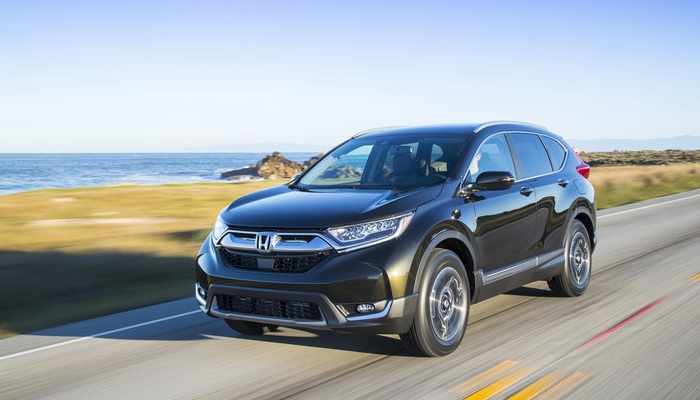 2019 Honda CR-V driving down an oceanside road