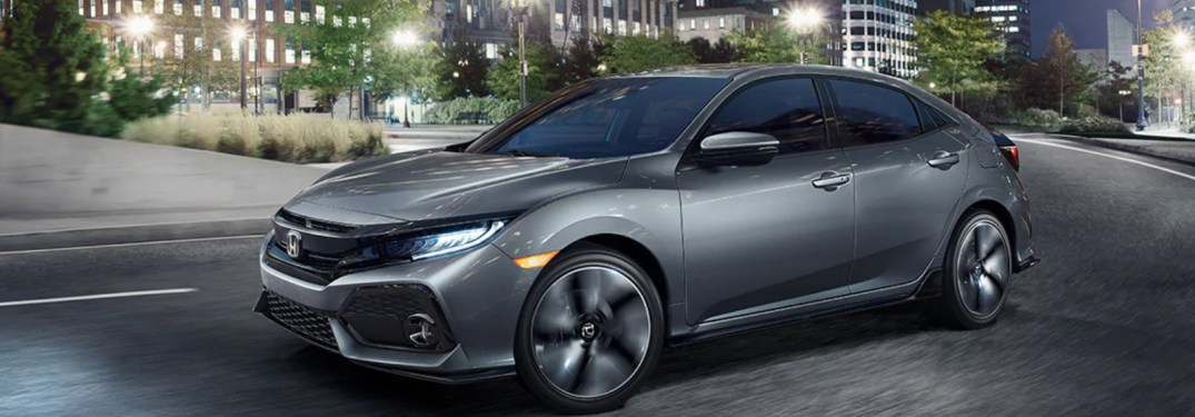 2019 Honda Civic Hatchback driving down a city street