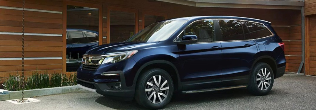 2019 Honda Pilot parked in front of a building