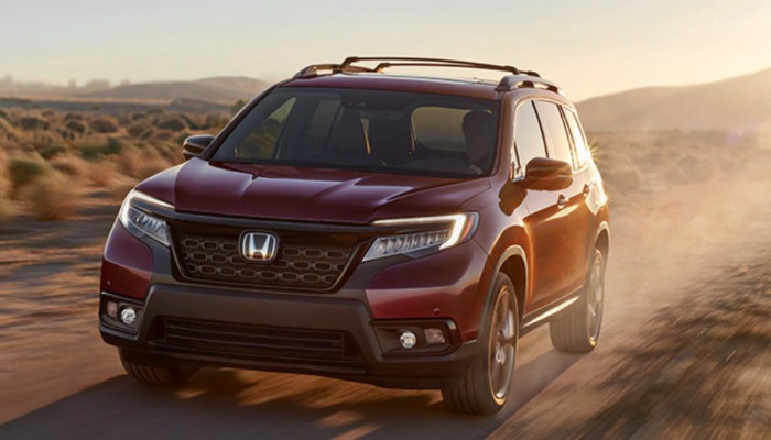 2019 Honda Passport driving down a dirt road