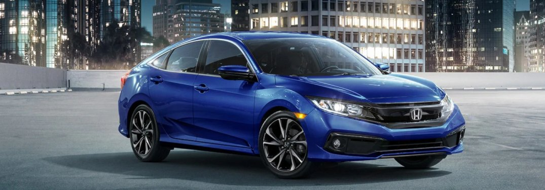 2019 Honda Civic Sedan driving down a city street
