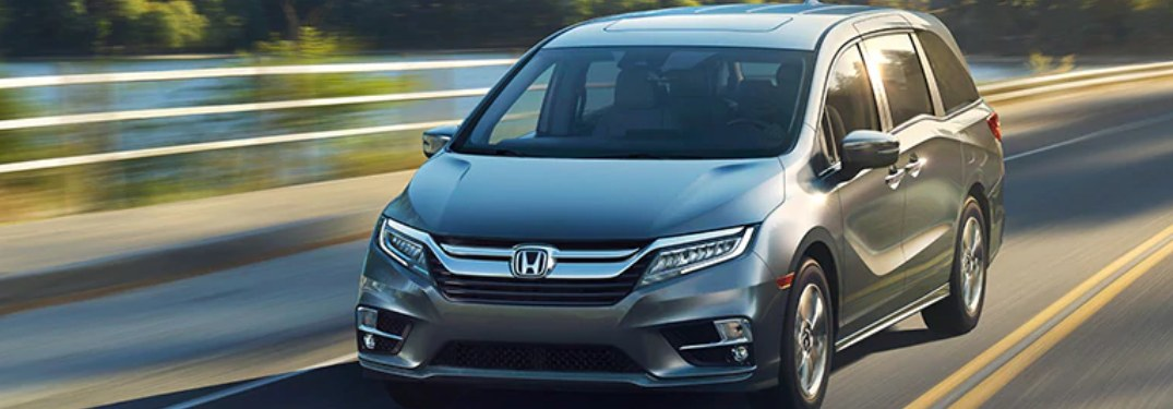 2019 Honda Odyssey driving on a bridge