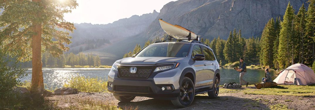 2019 Honda Passport parked in front of a lake
