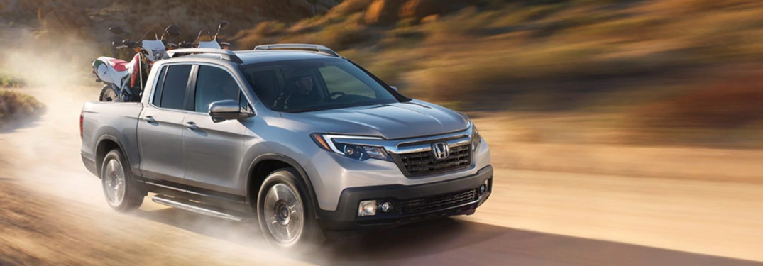 2019 Honda Ridgeline driving down a dirt path