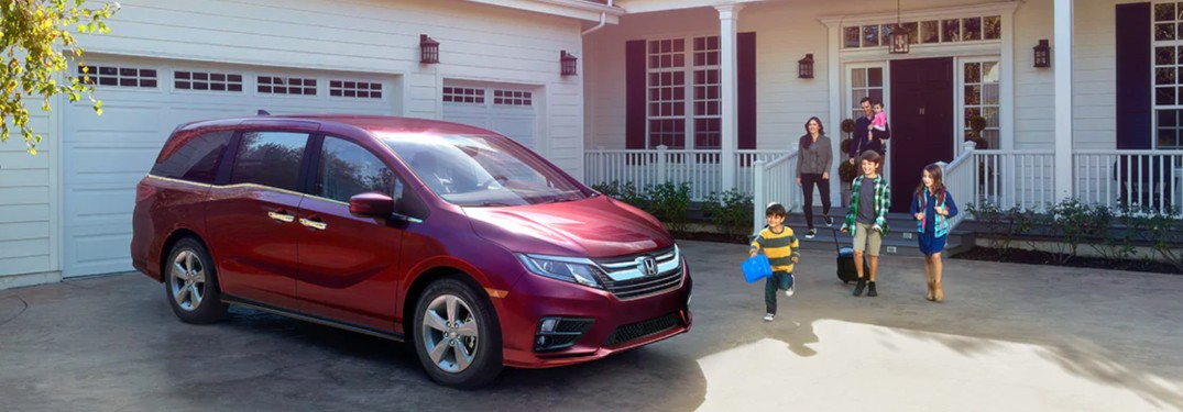 A family getting into a 2020 Honda Odyssey