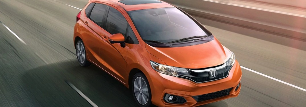 2019 Honda Fit driving down a highway