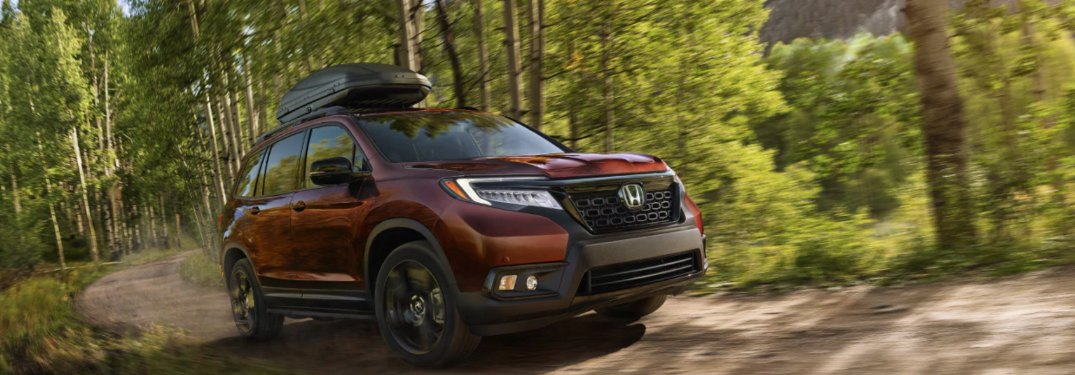 2019 Honda Passport driving down a forest road