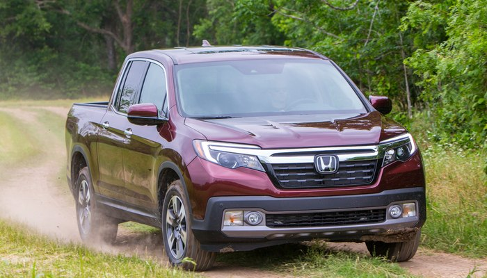 2019 Honda Ridgeline driving down a nature trail