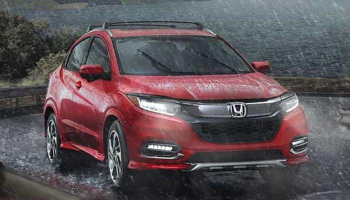 2019 Honda HR-V driving through the rain down a winding road