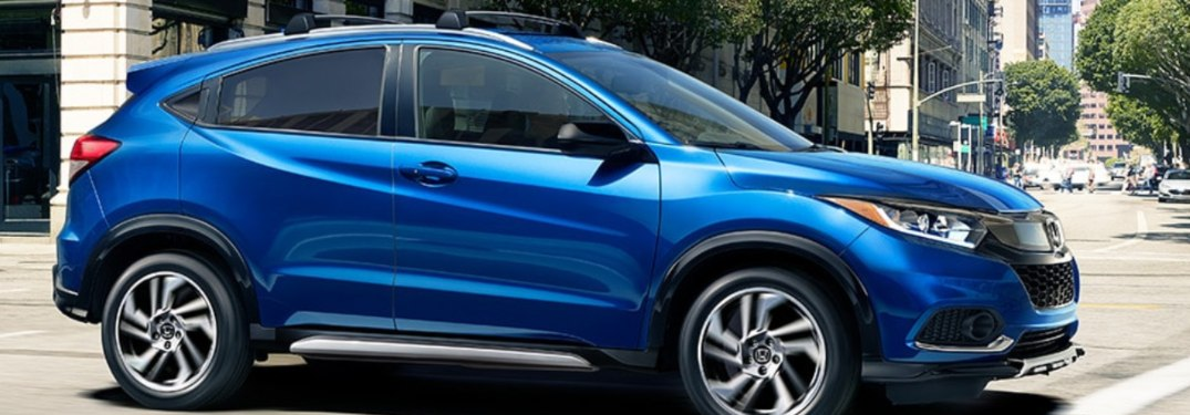 2019 Honda CR-V driving down a city street