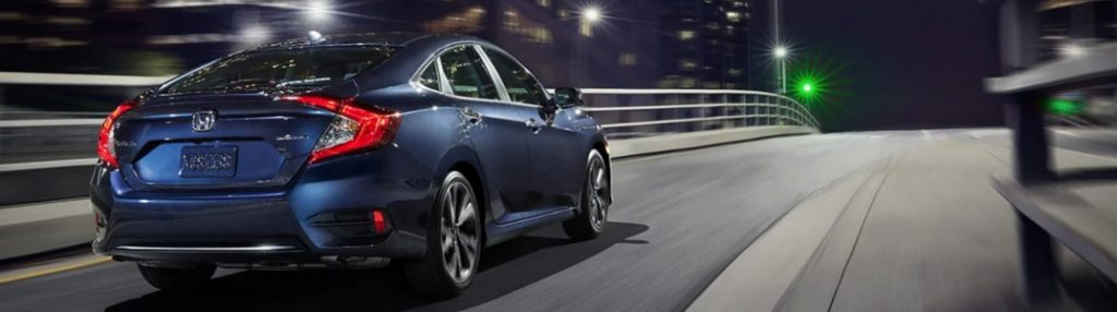 2020 Honda Civic Sedan driving on an overpass