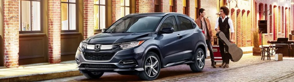 Two men conversing by a 2020 Honda HR-V