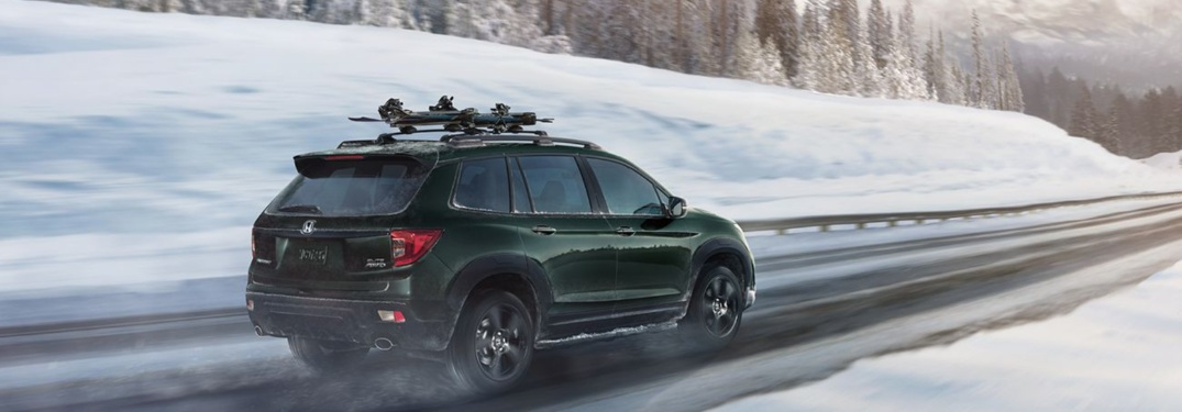 2020 Honda Passport driving down an icy highway