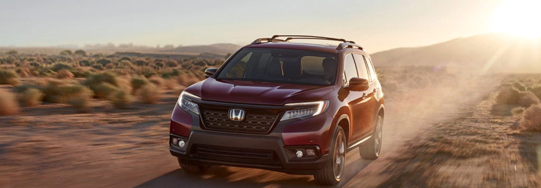 2020 Honda Passport driving down a rural road
