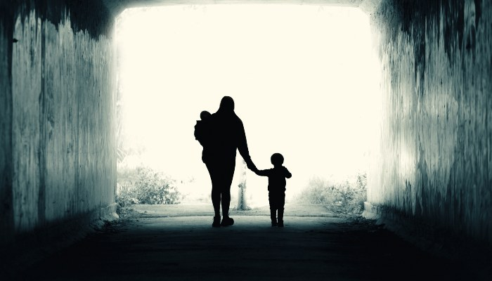 A family walking out of a tunnel
