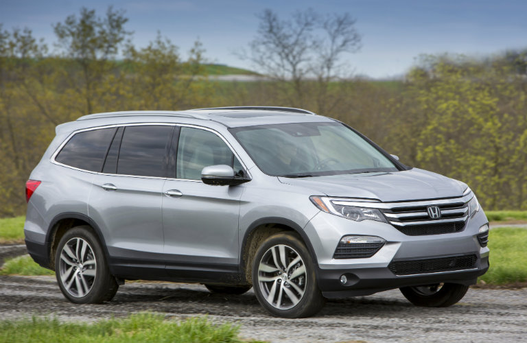 2017 Honda Pilot driving down a dirt trail