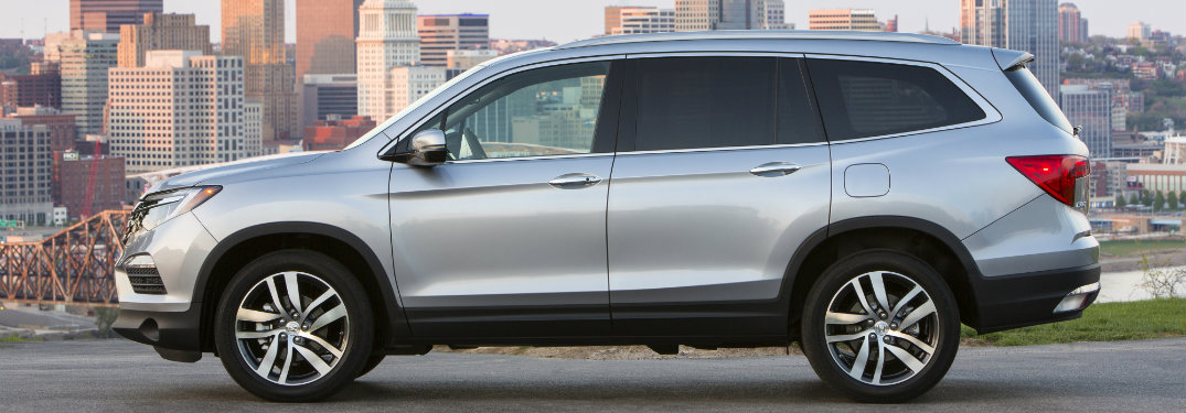2017 Honda Pilot driving down a city street