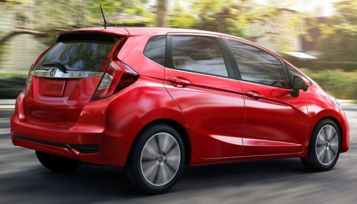2020 Honda Fit driving down a suburban street