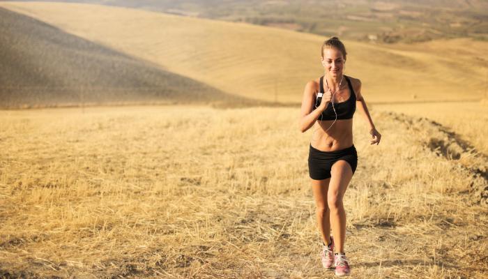A woman jogging in a field