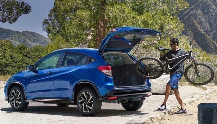 A man putting a bike into a 2020 Honda CR-V