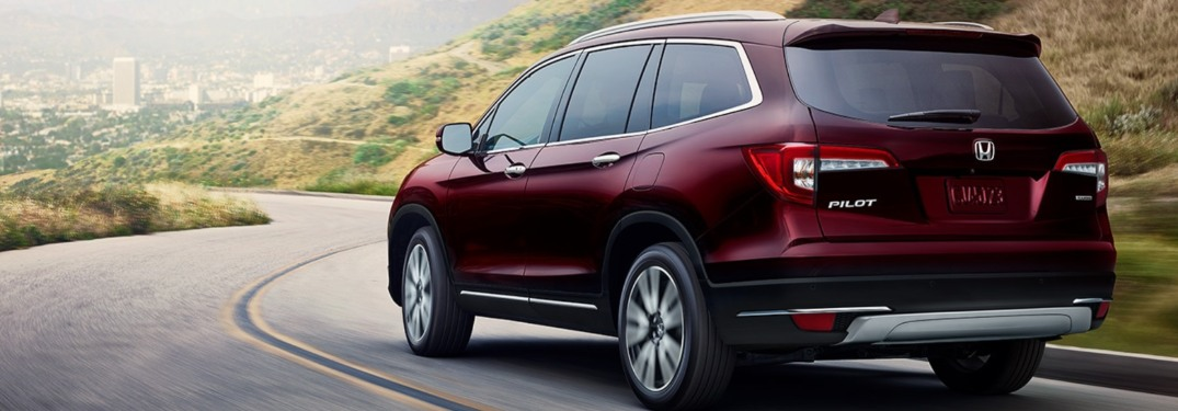 2021 Honda Pilot driving down a winding road