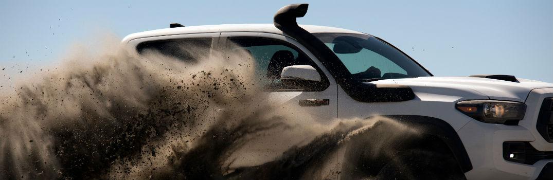 2019 Toyota Tacoma TRD Pro Series Exterior Passenger Side Profile Kicking Up Dust