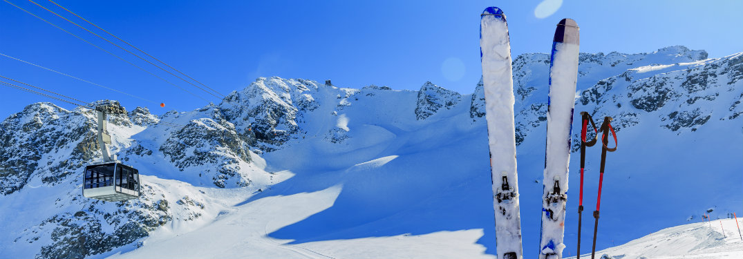 Skis-and-poles-stuck-in-snow-on-ski-mountain